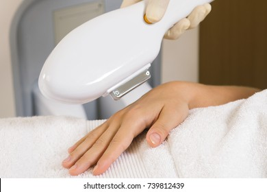 Woman during photoepilation or rejuvenation procedure
