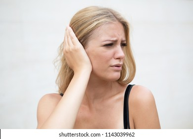 Woman with earache in summer
