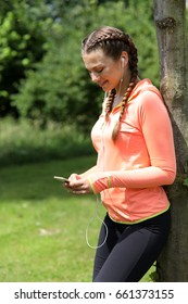 woman with earphones and smart phone