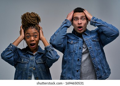 Woman with earrings with bun of braids with man with emotions in denim jackets
