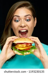 Woman eat burger. Close up face portrait girl with fast food.