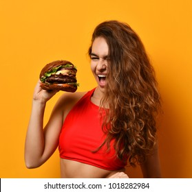Woman eat burger sandwich with hungry mouth on yellow background. Closeup composition of Fast food concept.