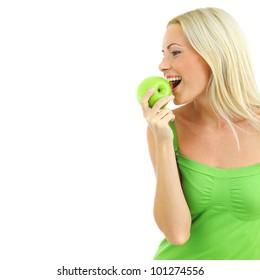 woman eat green apple on white