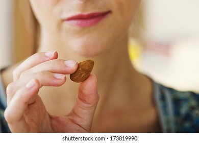 Woman Eating Almond