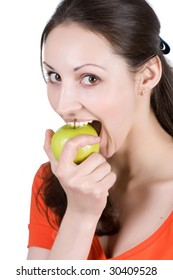 Woman eating apple on a white background
