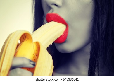 Woman Eating Banana Isolated on White. Sensual Red Lips With Banana. Blowjob Concept