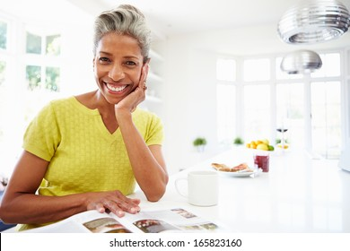 Woman Eating Breakfast And Reading Magazine