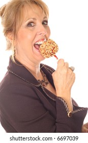 woman eating candy apple side