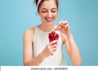 Woman eating cherries