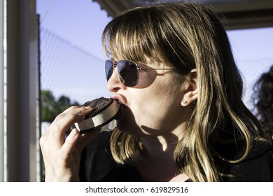 Woman eating chocolate ice cream in summer, desserts