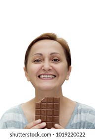 Woman eating chocolate isolated on white background. Nice portrait of a happy middle aged 40s 50s female smiling and holding a chocolate bar