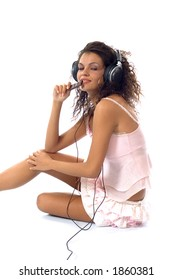 Woman eating chocolate and wearning headphone, listening to  music