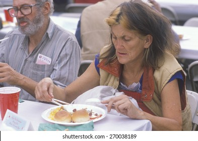 Woman eating Christmas dinner at homeless shelter, Los Angeles, California