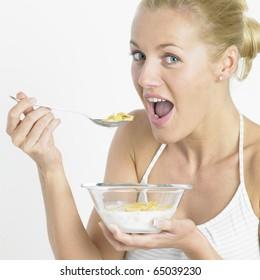 woman eating cornflakes
