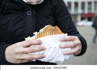Woman eating a Doner Kebab (sandwich)