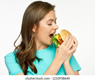 Woman eating fast food meal burger. Isolated close up female portrait.