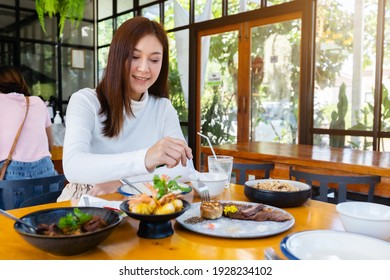 woman eating food in the restaurant