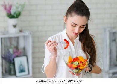 Woman eating fresh salad