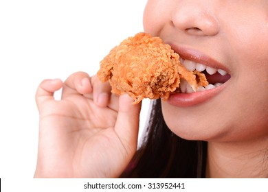 Woman eating fried chicken, on white background