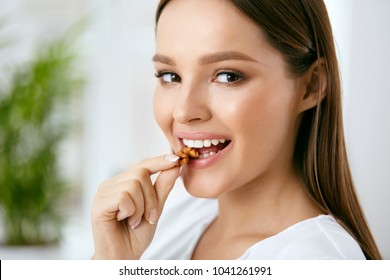 Woman Eating Healthy Diet Food In Kitchen