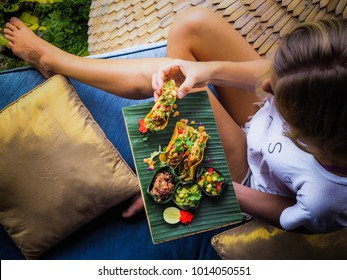 woman eating healthy vegan jackfruit tacos