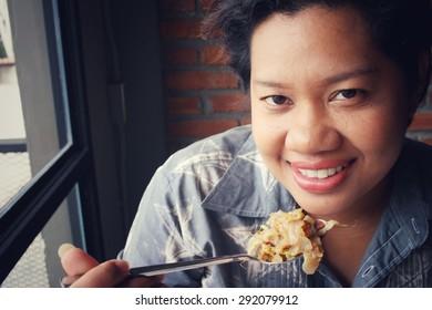 Woman eating pad thai