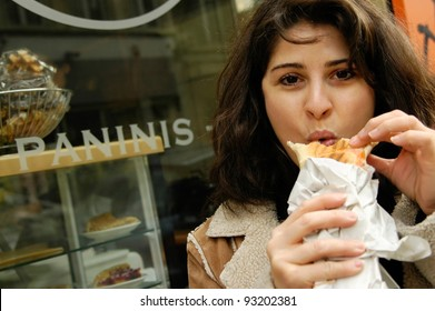 Woman eating panini at panini shop
