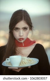 Woman eating pasta as taster or restaurant critic. woman with italian pasta and tea or coffee