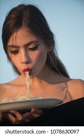 Woman eating pasta as taster or restaurant critic. Italian macaroni or spaghetti for dinner, cook. Chef woman with red lips eat pasta. Diet and healthy organic food, italy. Hunger, appetite, recipe.