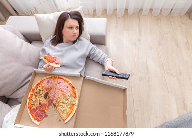 woman eating pizza image taken from above