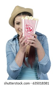 Woman eating popcorn isolated on white
