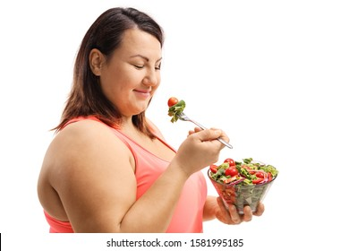 Woman eating a salad and trying to lose weight isolated on white background