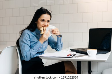 woman eating a sandwich at the office