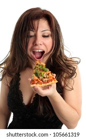 A woman eating a slice of delicious pizza.