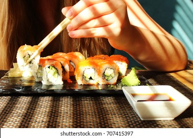 Woman is eating sushi