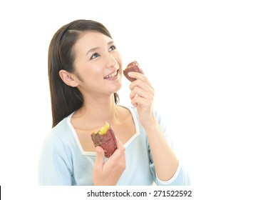 A Woman Eating Sweet Potato