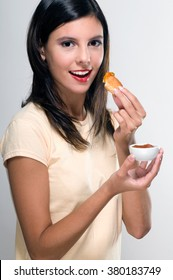 Woman eating a toast