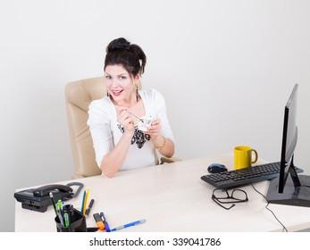 woman eating yogurt in office