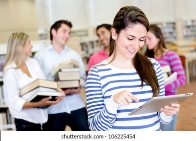Woman with an e-book reader while friends carry books