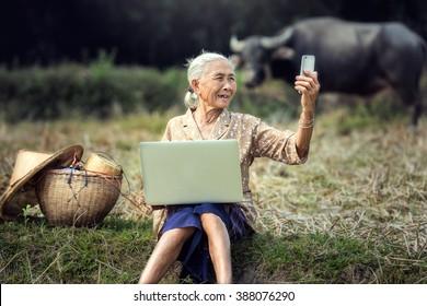 Woman elderly are using smartphone in selfie