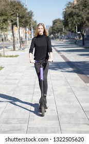 woman with electric scooter and no battery