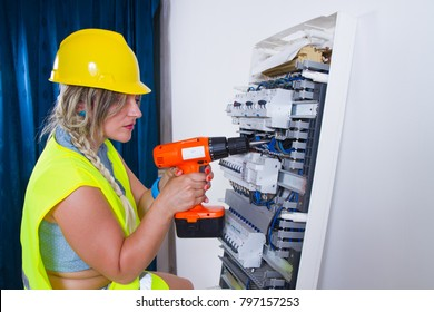 woman electrician fitting a plant