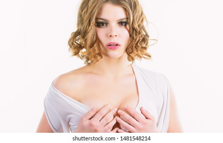 Woman elegant lady with retro hairstyle and makeup undressing white dress with seductive decollete. Impress him. Girl attractive seductive model on white background. Seductive girl take off clothes.