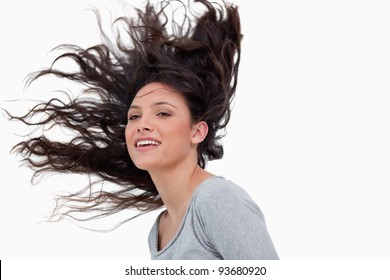 Woman with elevated hair against a white background