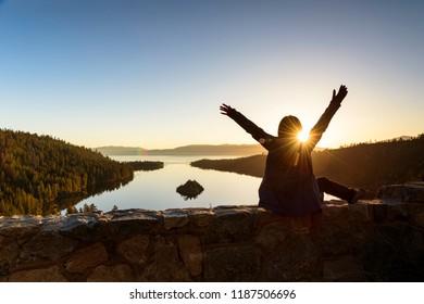 A woman embranced beautiful sunrise at Emerald Lake, California