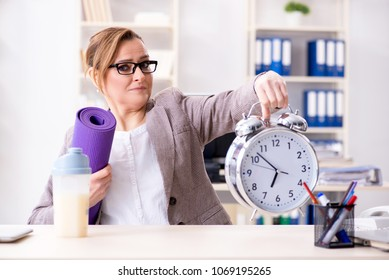 Woman employee going to sports from work during lunch break