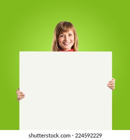 Woman with empty placard over green background