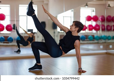 a woman is engaged in a gym, doing exercises