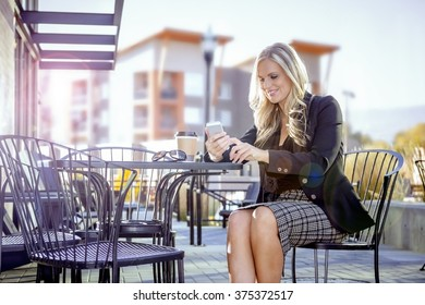 A Woman engaged in her handheld modern cell phone device