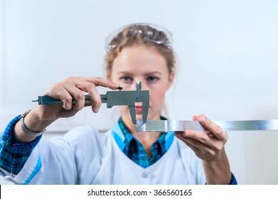 Woman engineer detail measure caliper